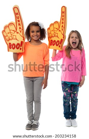 Enthusiastic sports fans with foam finger - stock photo