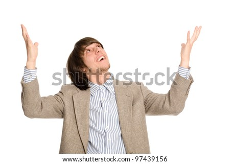 Enthusiastic young business man with arms raised. - stock photo