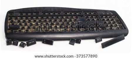 entirely dirty keyboard on white background - stock photo