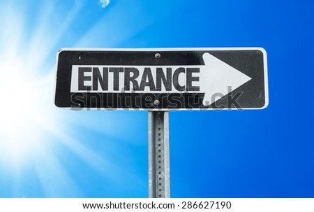 Entrance direction sign with a beautiful day - stock photo