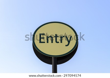 Entrance direction sign with sky background, England UK.