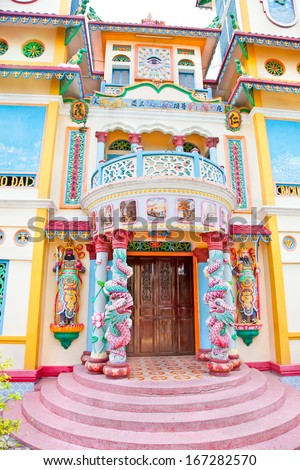 Entrance door of small Temple in village near Saigon city, Long An province, Vietnam.