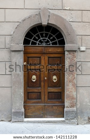 Entrance door on building in city Siena, Tuscany, Italy