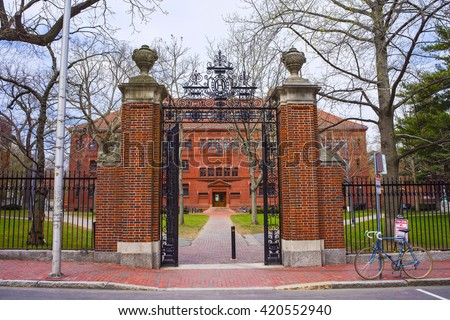 Entrance gate and East facade of Sever Hall at Harvard Yard in Harvard University in Cambridge, Massachusetts, MA, USA. It is used as the library, lecture hall and classroom for different courses. - stock photo