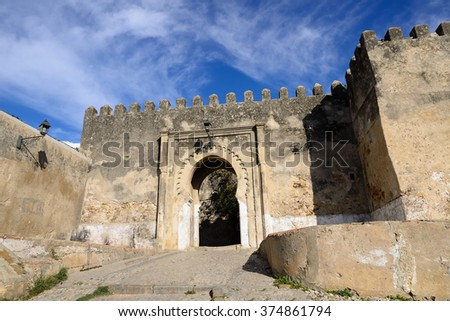 Entrance gate behind ancient walls of the old town (Medina) in Tanger, Morocco, Africa - stock photo