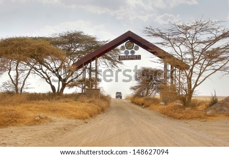 Entrance gate by the border of  the famous serengeti national park thats covering a big part of kenya and tanzania and contains many wild animals and the big five - stock photo