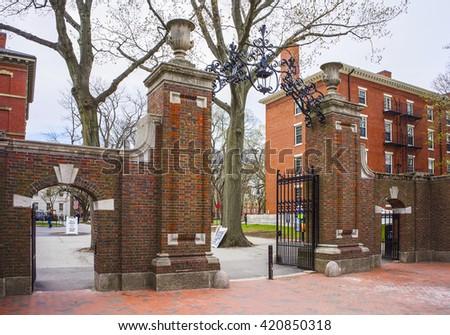 Entrance gates and a dormitory building in Harvard Yard of Harvard University in Cambridge, Massachusetts, MA, USA - stock photo