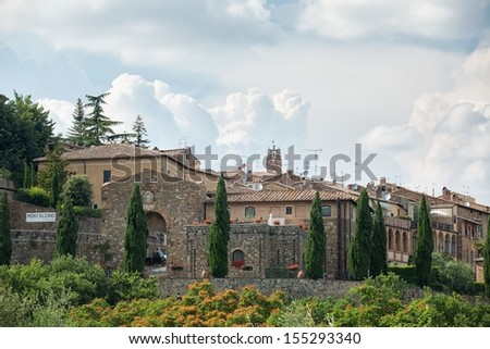 Entrance gateway to the picturesque town of Montalcino in Italy  - stock photo