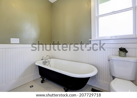 Entrance hallway in empty house. View of white entrance door and small table with red vase and dry branch - stock photo