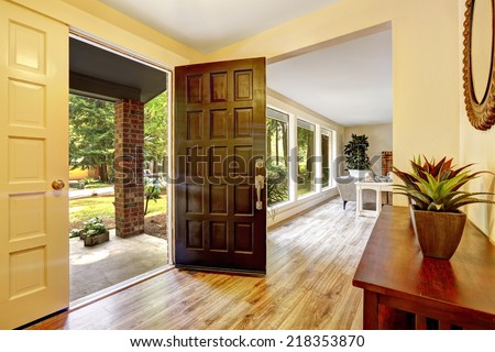 Entrance hallway with cabinet. View of entrance porch through open door - stock photo