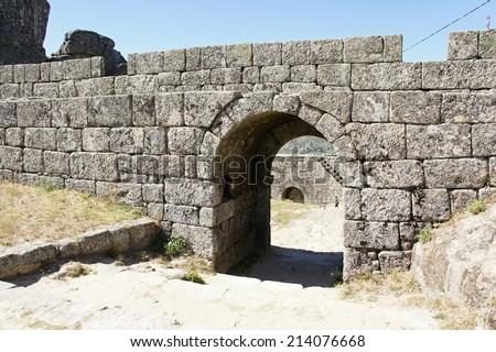 Entrance in bulwark of castle in Monsanto, Portugal - stock photo