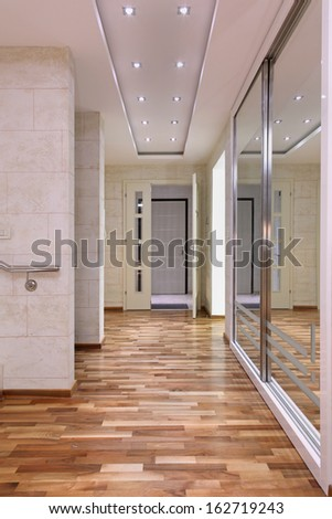Entrance interior corridor inside large house and big mirror on the wall
