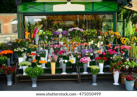 Entrance into small flower shop stock photo royalty free for Flower shop design layouts