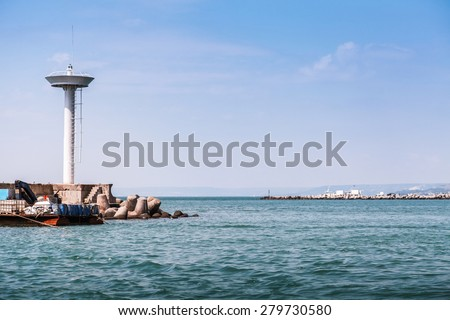 Entrance lighthouse of Kavarna, coastal town and seaside resort in the Dobruja region of northeastern Bulgaria, Black Sea coast - stock photo