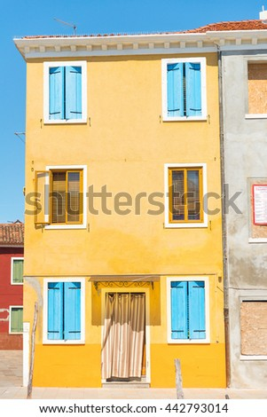 Entrance of a colorful apartment building in Burano, Venice, Italy,Europe