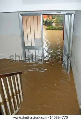 entrance of a House fully flooded during the flooding of the river - stock photo