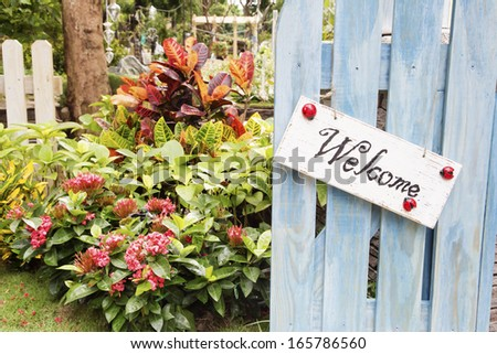 Entrance of a house with opened blue wooden door - stock photo