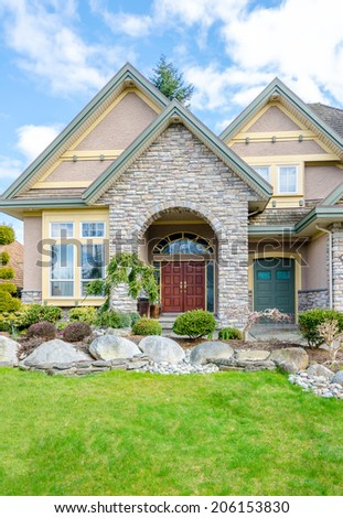 Entrance of a luxury house on a bright, sunny day in Vancouver, Canada - stock photo