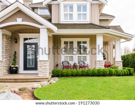 Entrance of a luxury house with a patio on a bright, sunny day in Vancouver, Canada - stock photo