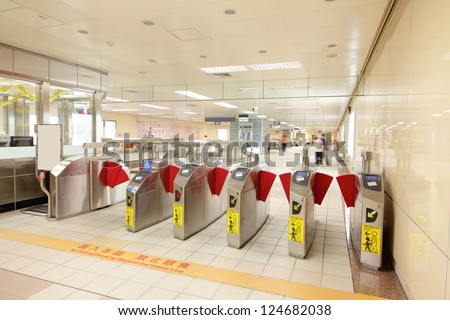 Entrance of a metro railway station with motion blur people,  shot in Taipei, Taiwan, asia - stock photo