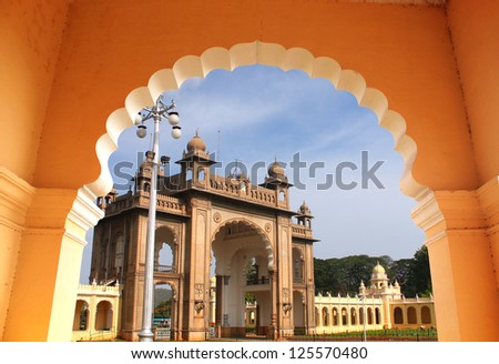 Entrance of majestic mysore palace from an arch. The palace is a historic monument located in mysore in south karnataka, India and is a huge tourist attraction. - stock photo