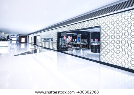 entrance of retail store in bright hall - stock photo