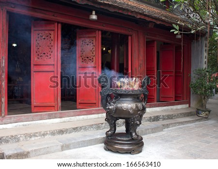 Entrance of temple with the incense burner, Vietnam, Hanoi, Temple of the Jade Mountain  - stock photo