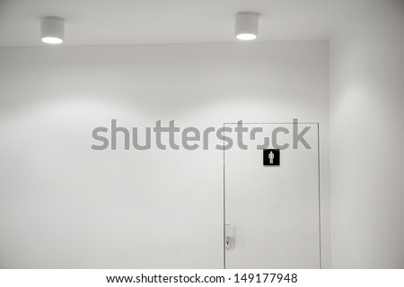 Entrance of the men public toilet in museum - stock photo