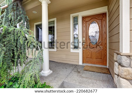 Entrance porch with wooden entrance door
