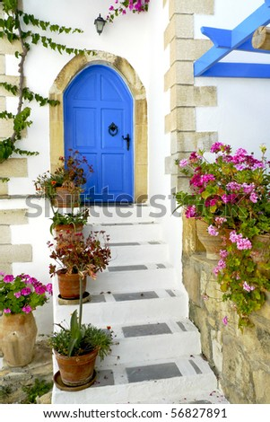 Entrance to a Greek house with a traditional blue door on Crete, Greece - stock photo