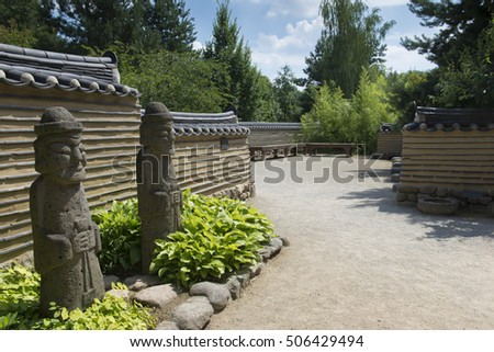 Entrance to a traditional Korean garden with statues of gods