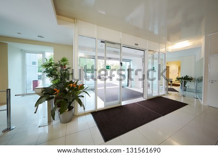 Entrance to administrative building equipped with automatic door - stock photo