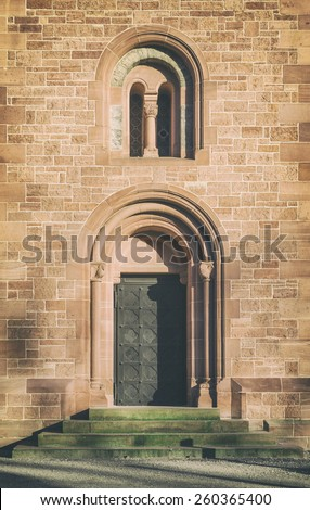 Entrance to an old church. Vintage filter effects. - stock photo