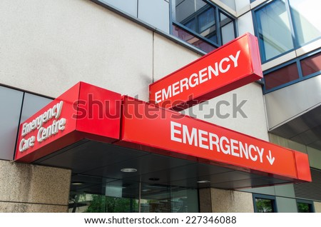 Entrance to and signage for a hospital emergency department in Melbourne, Australia - stock photo