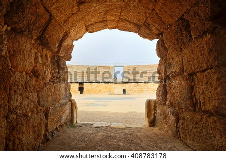 Entrance to antique amphitheater in Israel. - stock photo