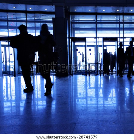 Entrance to modern building and people silhouettes - stock photo