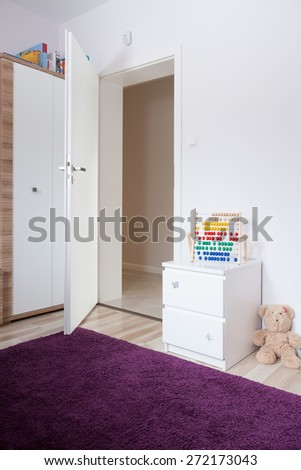 Entrance To Modern Children Room With Purple Carpet