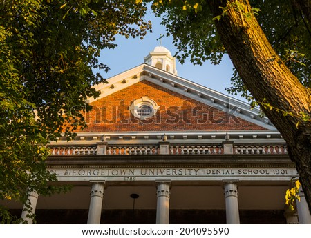 Entrance to old building for School of Medicine and Dentistry and Georgetown University Hospital in Washington DC - stock photo