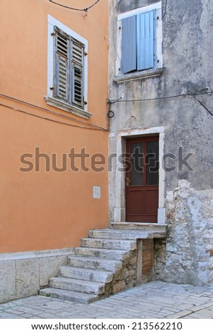 Entrance to old house with stone stairs