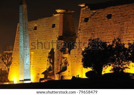 entrance to the ancient egyptian temple of Luxor. Giant statues of Ramses  II enthroned and the great obelisk in the town centre. Egypt