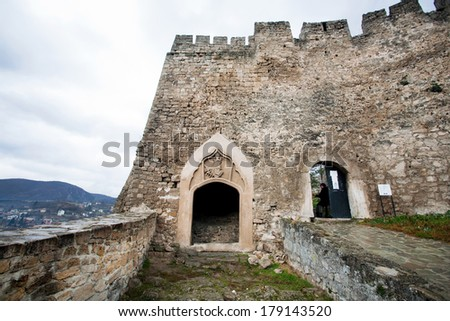 Entrance to the ancient stone fortress on the top of the hill in the Bosnian city Jajce, Bosnia and Herzegovina.  - stock photo