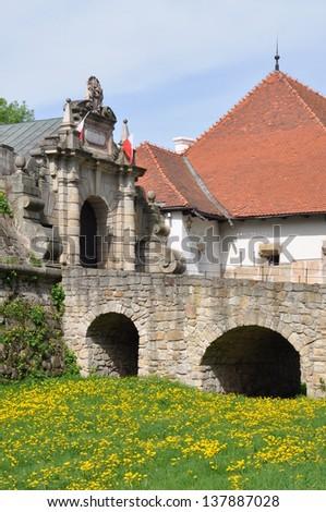 Entrance to the castle Wisnicz, Poland - stock photo