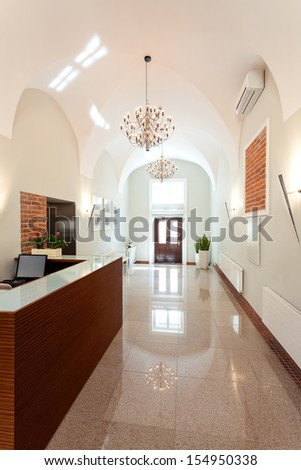Entrance to the hotel and reception desk