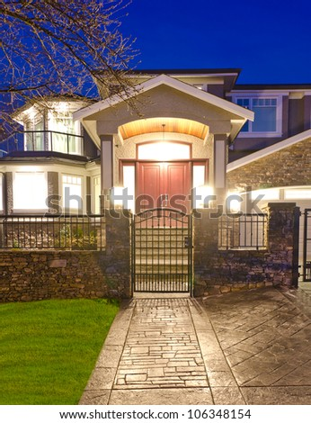 Entrance to the house at night time - stock photo