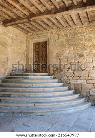 Entrance to the monastery. Detail of the entrance and stairs of an ancient monastery.