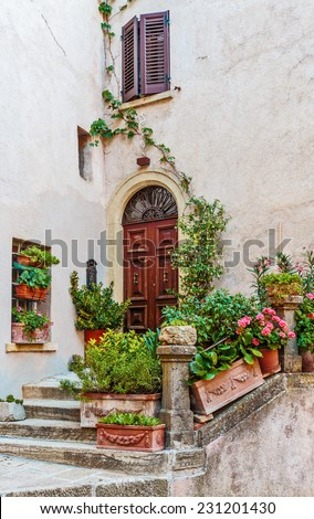 Entrance to the old Italian house - stock photo