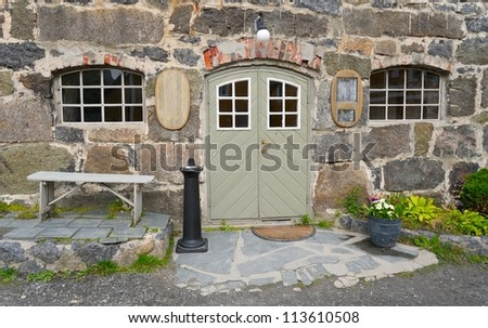 Entrance to the old stone tavern - stock photo