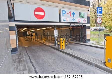 Entrance to the parking lot. - stock photo