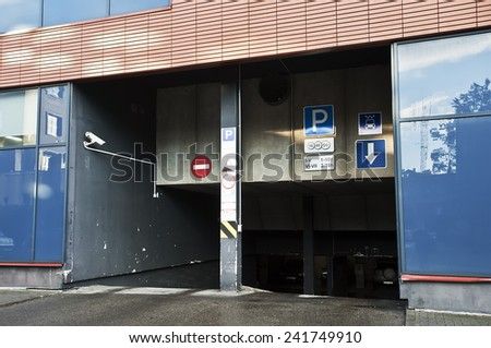 Entrance to the parking lot - stock photo
