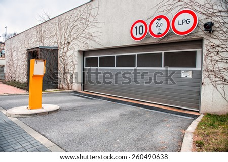 Entrance to the parking lot in residential house   - stock photo